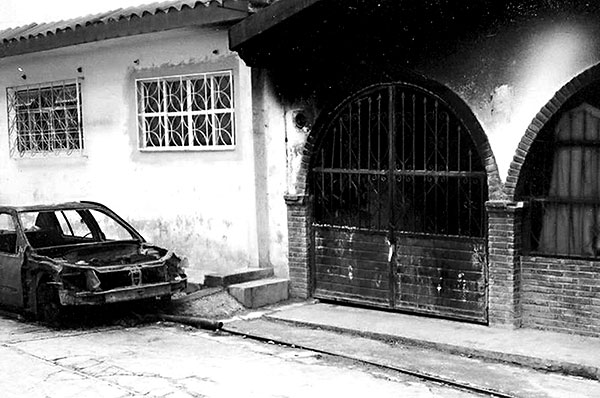 House burned during the fighting in Tila, February 15, 2005