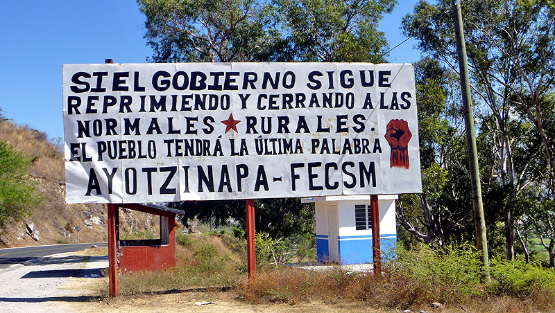 Sign at the entrance of the Ayotzinapa community © SIPAZ