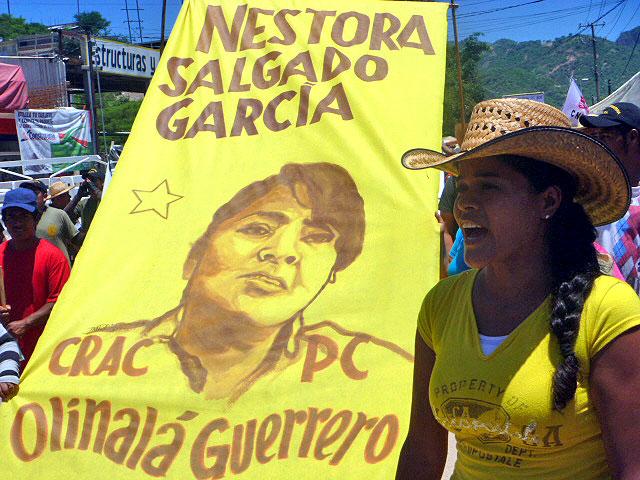 """Nestora Salgado banner at the Tlachinollan anniversary, July 2014 © SIPAZ Libertad: """"Presos políticos libertad"""", lona en el marco del aniversario de Tlachinollan, julio de 2014 © SIPAZ"""